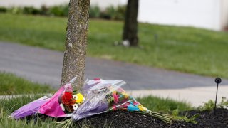 Flowers lay in a makeshift memorial