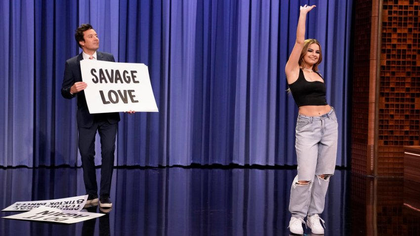 """In this March 26, 2021, file photo, singer Addison Rae teaches host Jimmy Fallon TikTok dances on """"The Tonight Show Starring Jimmy Fallon."""""""
