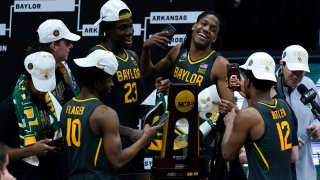 Baylor players celebrate with the trophy at the end of the championship game against Gonzaga in the men's Final Four NCAA college basketball tournament, Monday, April 5, 2021, at Lucas Oil Stadium in Indianapolis. Baylor won 86-70.