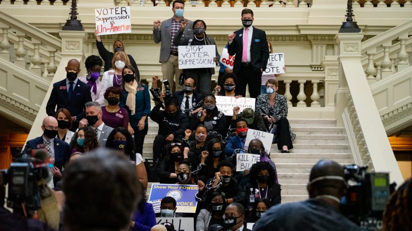 Demonstrators hold a sit-in inside of the Capitol building in opposition of House Bill 531 on March 8, 2021 in Atlanta, Georgia. HB531 will restrict early voting hours, remove drop boxes, and require the use of a government ID when voting by mail.