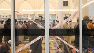 Malaysian Muslims perform tarawih prayers on the first night of Ramadan at a mosque in Selangor on April 12, 2021.
