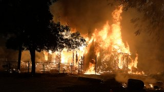 Home burning in fast-moving Lightning Complex Fire