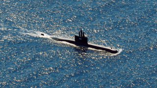 In this aerial photo taken from a maritime patrol aircraft of 800 Air Squadron of the 2nd Air Wing of Naval Aviation Center (PUSPENERBAL), the Indonesian Navy submarine KRI Alugoro sails during a search for KRI Nanggala, another submarine that went missing while participating in a training exercise on Wednesday, in the waters off Bali Island, Indonesia, Thursday, April 22, 2021. Indonesia's navy ships on Thursday were intensely searching for the submarine that likely fell too deep to retrieve, making survival chances for all the crew on board slim. Authorities said oxygen in the submarine would run out by early Saturday.