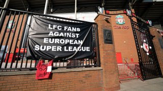 A banner is seen outside Liverpool's Anfield Stadium protesting the formation of the European Super League, Liverpool, England, Monday, April 19, 2021. Players at the 12 clubs setting up their own Super League could be banned from this year's European Championship and next year's World Cup, UEFA President Aleksander Ceferin said Monday.