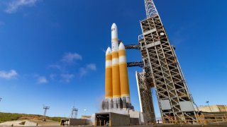 A Delta IV Heavy rocket sits on the launch pad April 26, 2021 at Vandenberg Air Force Base.