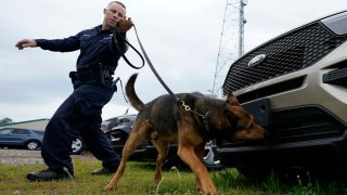 Virginia State Police K-9 officer Tyler Fridley, works his dog Aries at State Police headquarters in Richmond, Va.