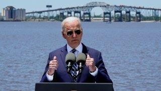 President Joe Biden speaks with the Interstate 10 Calcasieu River Bridge behind him, Thursday, May 6, 2021, in Lake Charles, La.