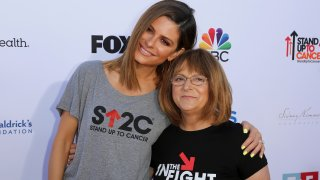 In this Sept. 7, 2018, file photo, Maria Menounos, left, and her mother Litsa Menounos arrive at the 2018 Stand Up To Cancer event at the Barker Hangar at the Santa Monica airport in Santa Monica, California.