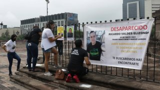Family of Ricardo Valdes, who disappeared on the road on May 25, put up posters with their photography during a protest in Monterrey, Nuevo Leon state, Mexico.