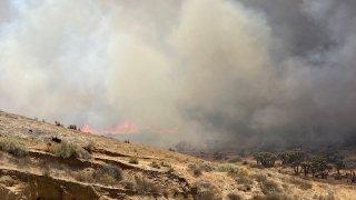 A brush fire burns in Hesperia.