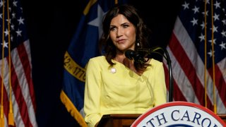 South Dakota Gov. Kristi Noem speaks to attendees at the North Carolina GOP convention on June 5, 2021 in Greenville, North Carolina. Former U.S. President Donald Trump is scheduled to speak at the NCGOP state convention in one of his first high-profile public appearances since leaving the White House in January.