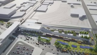 A rendering shows part of the LAX Automated People Mover project.
