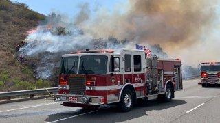 Brush burns along Highway 73 in Orange County.