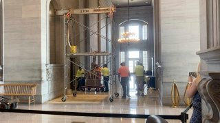 The Nathan Bedford Forrest bust is removed from inside of the Tennessee Capitol