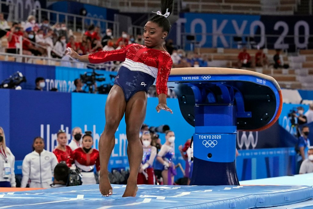 Simone Biles lands from the vault