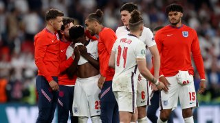 England players comfort teammate Bukayo Saka