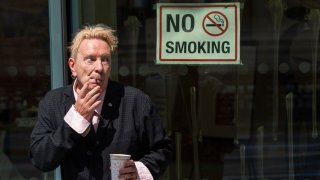 John Lydon, also known as Johnny Rotten, outside the Hight Court Rolls Building in London