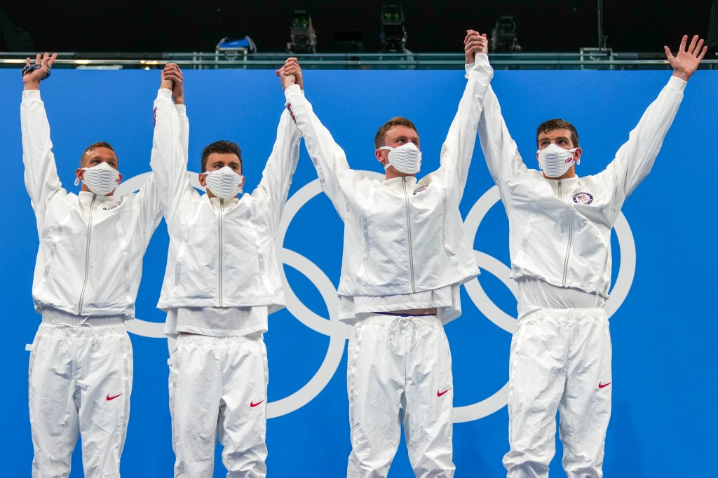 United States men's 4x100m freestyle relay team of Caeleb Dressel, Blake Pieroni, Bowen Beck and Zach Apple, celebrate on the podium after winning the gold medal at the 2020 Summer Olympics, Monday, July 26, 2021, in Tokyo, Japan.