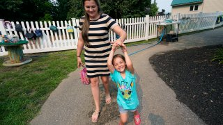 Brianne Walker leaves A Place To Grow daycare with her 3-year-old daughter, Jeannette