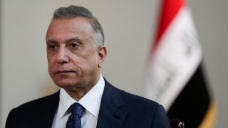 Iraqi Prime Minister Mustafa al-Kadhimi poses in his office during an interview with The Associated Press in Baghdad, Iraq, July 23, 2021.