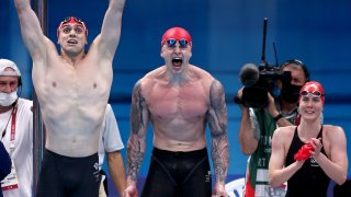 James Guy, Adam Peaty, Kathleen Dawson and Anna Hopkin of Great Britain react during the Mixed 4 x 100m Medley Relay Final