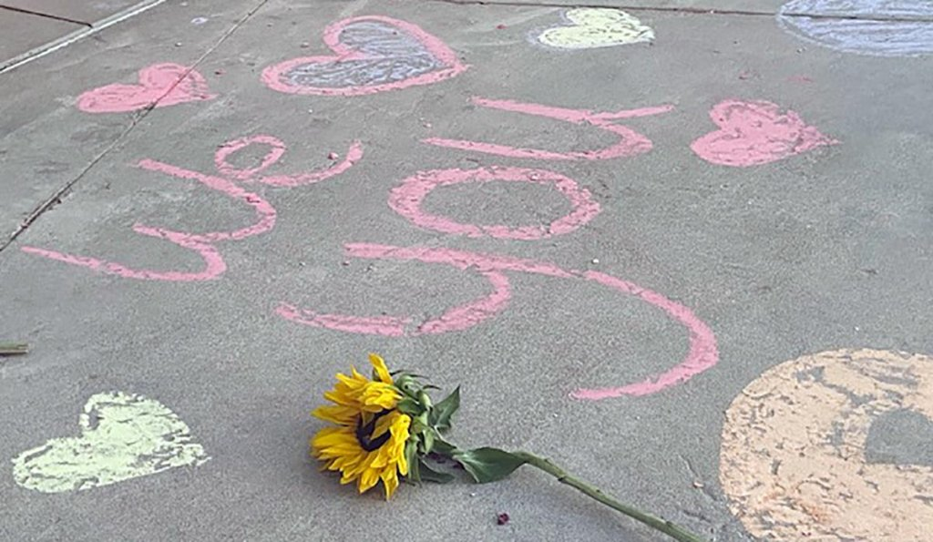 Messages in honor of Rylee Goodrich, 19, and Anthony Barajas, 18, were left outside a movie theater at The Crossings mall in Corona.