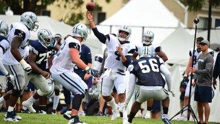 FILE: Dallas Cowboys QB Dak Prescott (4) passing during preseason training camp at River Ridge Playing Fields in Oxnard, California on July 28, 2018.