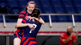 Rose Lavelle celebrates scoring the opening goal for the USWNT against New Zealand with teammate Tobin Heath.
