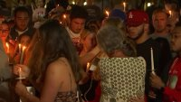 Vigil Held for Victims in Movie Theater Shooting in Corona