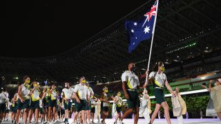 flag bearers Cate Campbell and Patty Mills of Team Australia