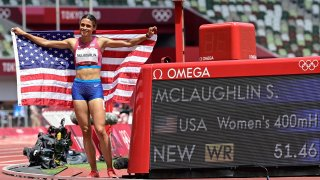 USA's Sydney Mclaughlin celebrates after winning the women's 400m hurdles final setting a new world record during the Tokyo 2020 Olympic Games