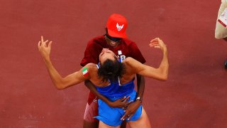Gianmarco Tamberi of Italy and Mutaz Essa Barshim of Qatar embrace after deciding to share gold