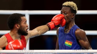 U.S. featherweight Duke Ragan (in red) beat Sam Takyi of Ghana to earn a spot in the finals at the Tokyo Olympics.