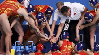 China in a water polo huddle