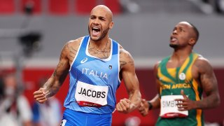 Lamont Marcell Jacobs of Team Italy celebrates after winning the Men's 100m Final