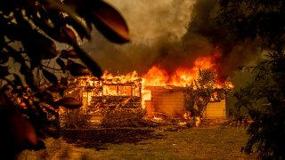 Flames consuming house as Fawn Fire burns
