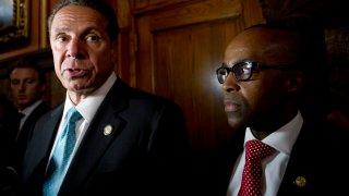 New York Gov. Andrew Cuomo, left, Alphonso David, right