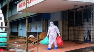 A health official stands outside the Kozhikode Medical College Hospital ward