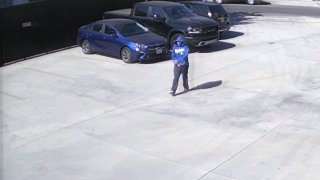 Security camera video shows a person sought in a fatal shooting in El Sereno walking across a parking lot.