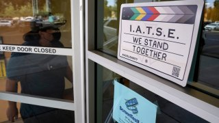 A man enters the union offices of The International Alliance of Theatrical Stage Employees (IATSE) Local 80, Monday, Oct. 4, 2021, in Burbank, Calif.