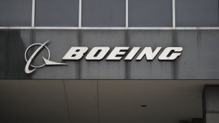 """CHICAGO, March 13, 2019 -- Photo taken on March 13, 2019 shows the Boeing logo at its headquarters in downtown Chicago, the United States. U.S. aircraft manufacturer Boeing said Wednesday it has """"full confidence"""" in the safety of its 737 Max aircraft, but it supports action to temporarily ground the entire global fleet of 737 Max """"out of an abundance of caution."""""""