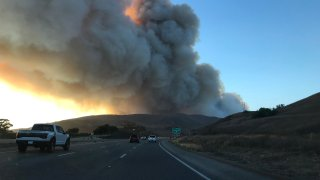 Wildfire smoke fills the sky over the 101 Freeway in Santa Barbara.