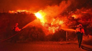 Firefighters knock down flames during the Alisal Fire near Santa Barbara.