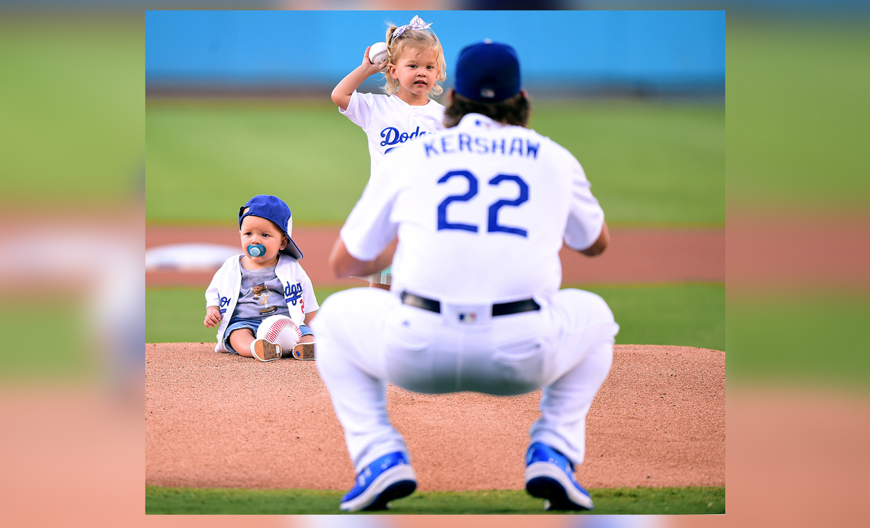 Cali Ann Kershaw throws throws out a ceremonial first pitch to her dad Clayton Kershaw #22 of the Los Angeles Dodgers as brother Charley Kershaw sits on the mound, before the game against the Minnesota Twins at Dodger Stadium on July 26, 2017 in Los Angeles, California. (Photo by Harry How/Getty Images)