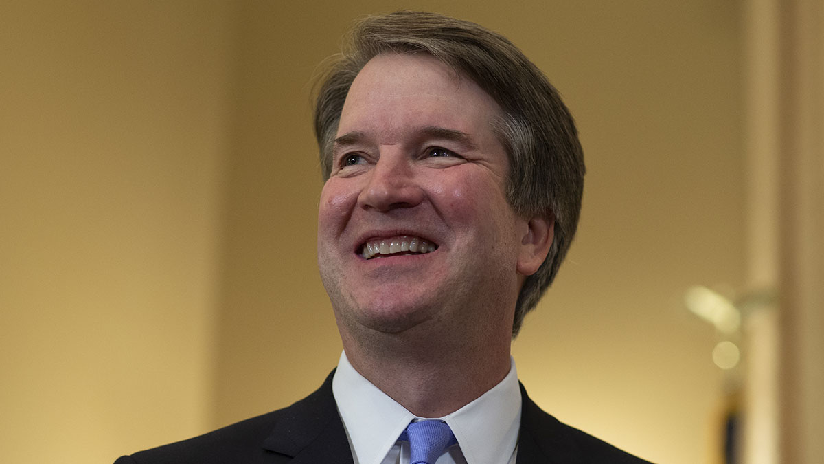 Judge Brett Kavanaugh (L) smiles prior to a meeting with Sen. Benjamin Sasse (R-NE) in the Russell Senate Office Building on July 12, 2018 in Washington, DC.