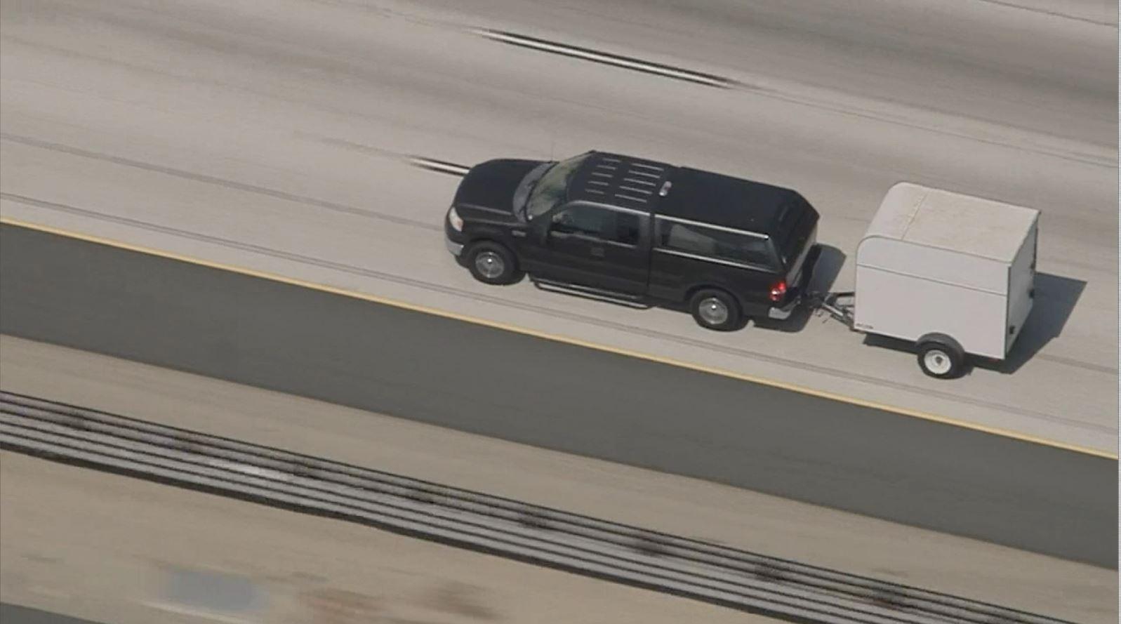 Deputies pursue a pickup pulling a trailer Monday Sept. 18, 2017 in San Bernardino County.