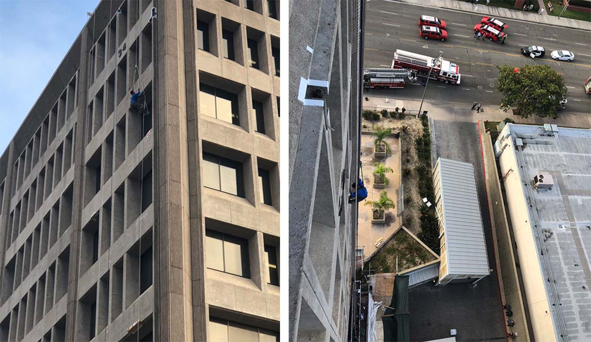A worker is seen dangling from a rope outside a building Tuesday Oct. 23, 2018 in Santa Ana.