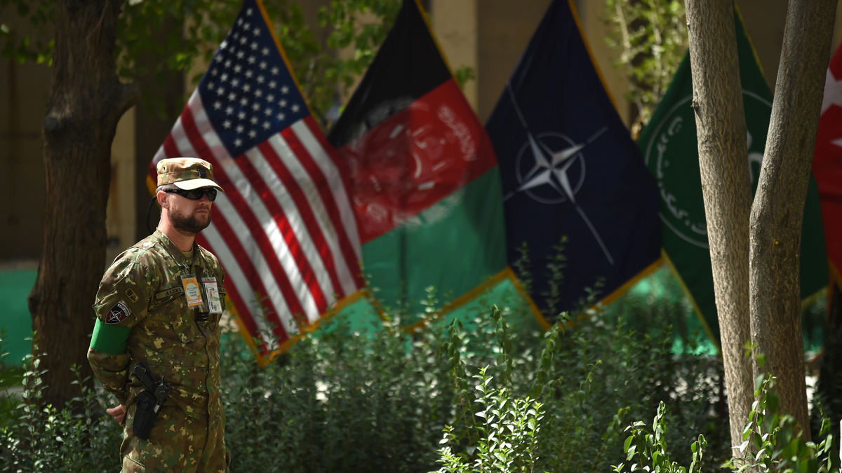 In this Sept. 2, 2018, file photo, a U.S. military serviceman stands during a change of command ceremony at Resolute Support in Kabul, Afghanistan.