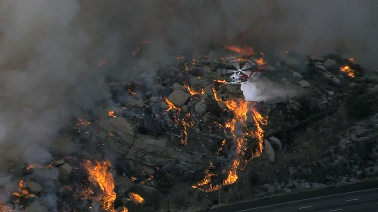 A brush fire burns near the 118 Freeway Monday Nov. 12, 2018.
