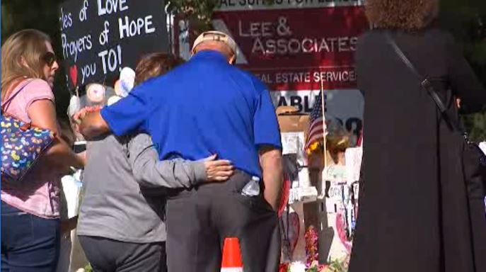 Mourners gather to remember Tuesday, Nov. 13, 2018 the victims of the shooting at the Borderline Bar & Grill in Thousand Oaks.